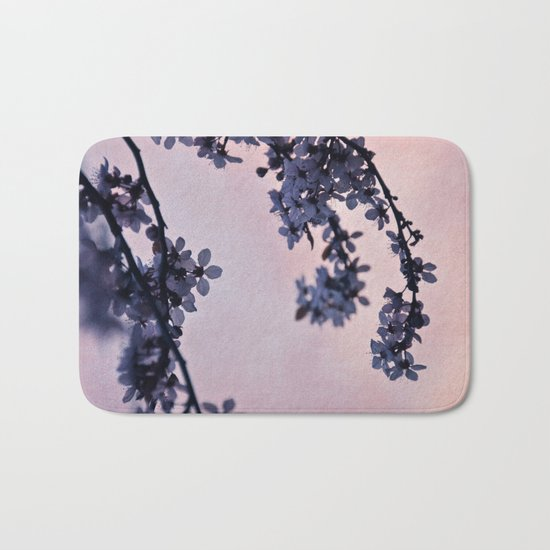 blossoms at dusk Bath Mat
