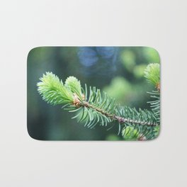 Spruce branch in spring. Bath Mat