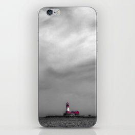 Red lighthouse on a cloudy day iPhone Skin