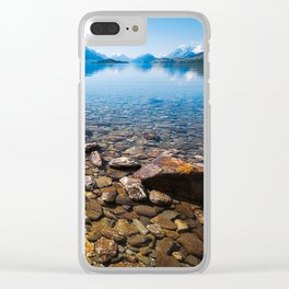 Snow-capped mountains view in summer from the rocky shore of lake Wakatipu. Clear iPhone Case