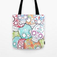 sugar skulls Tote Bags featuring skulls sugar by wet yeti