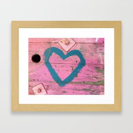Blue heart on pink Framed Art Print