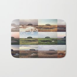 the clump through the seasons Bath Mat
