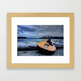 This Guitar, it is a beach bum. Framed Art Print