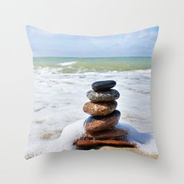 Stones in pyramid and wave on sand beach Throw Pillow