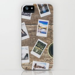 Photo prints on the table iPhone Case