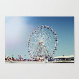 Fairground and ferris wheel against a blue sky, Blackpool Canvas Print