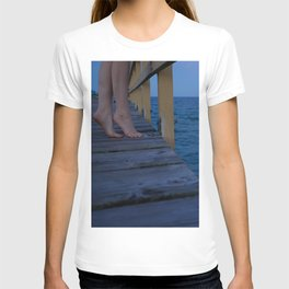 Woman standing on the edge of a pier T-shirt