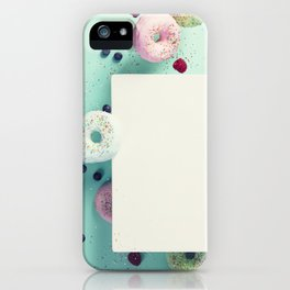 Sweet and colourful doughnuts with sprinkles and berries falling or flying in motion iPhone Case
