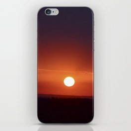Sunset over the forest in the dark night iPhone Skin
