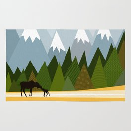 Woodland snowy mountain tops trees and mother moose and baby Rug