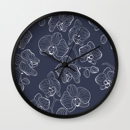 Retro . Orchid flowers on a blue background . Wall Clock