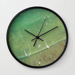Drone Shot of Surfers from above Wall Clock