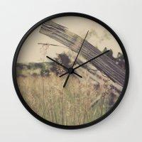 battlefield Wall Clocks featuring Battlefield Fence by Sam Wesselhoft