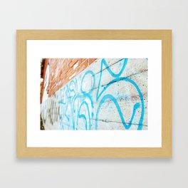 Blue graffiti on concrete wall Framed Art Print