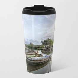 Boats in a lagoon port Travel Mug