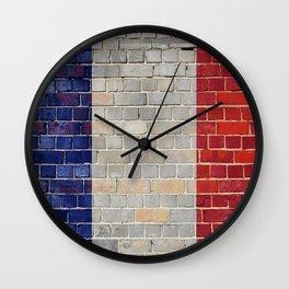 France flag on a brick wall Wall Clock