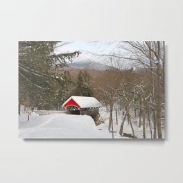 Red covered bridge in snowy landscape Metal Print