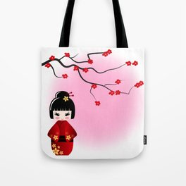 Japanese kokeshi doll at sakura blossoms Tote Bag