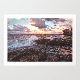 Seascape at sunset in a rocky beach Art Print