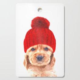 Cocker spaniel puppy with hat Cutting Board