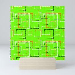 White and red carved squares and black frames for an abstract green background or pattern. Mini Art Print