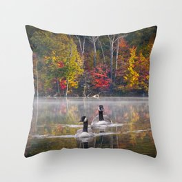 Two Canada Geese swimming in Fall Throw Pillow