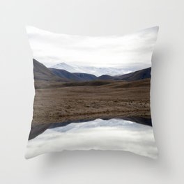 Reflections of the Rolling Hills and Snow-Covered Mountains on the Road to Edoras Throw Pillow