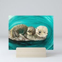 Cuddling Mama and Baby Sea Otters Mini Art Print