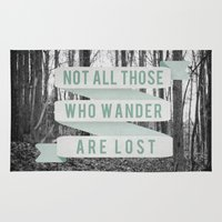 not all who wander are lost Area & Throw Rugs featuring Not All Those Who Wander Are Lost by Sanguine Eyes