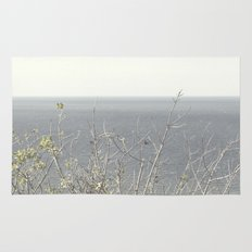 Branches at the sea Rug