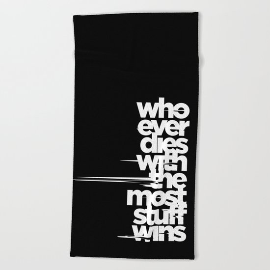 whoever dies with the most stuff wins Beach Towel