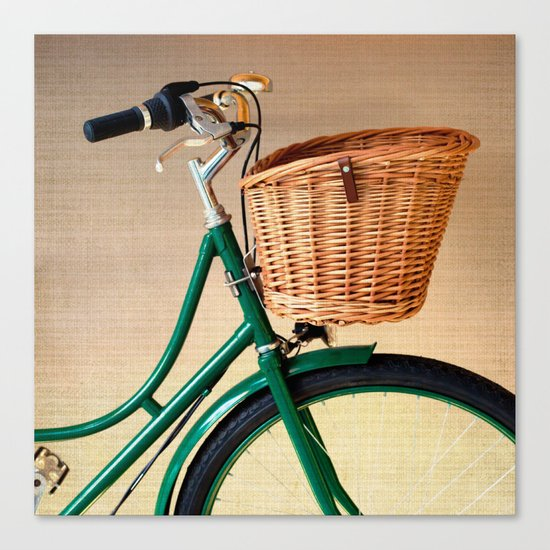 Vintage green bicycle with basket and textured background  Canvas Print