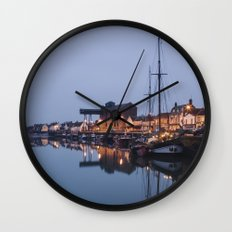 Boats and harbour at dawn twilight. Wells-next-the-sea, Norfolk, UK. Wall Clock
