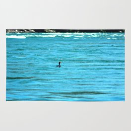 Swimming alone Rug