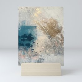 Embrace: a minimal, abstract mixed-media piece in blues and gold with a hint of pink Mini Art Print