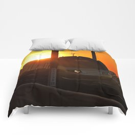 Train at sunset Comforters