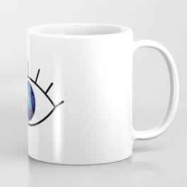 Galaxy inside big blue eyes with text above Coffee Mug