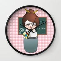 teacher Wall Clocks featuring Kokeshi Teacher  by Pendientera