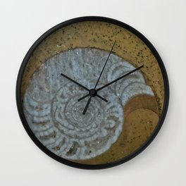Ammonite in fossilized river bed Wall Clock