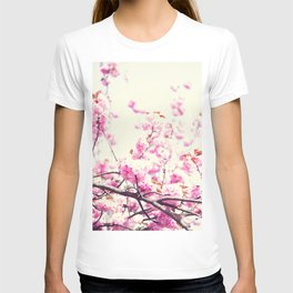 Pink cherry blossoms over white T-shirt