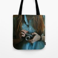 photographer Tote Bags featuring Photographer by Jelena Pejovic
