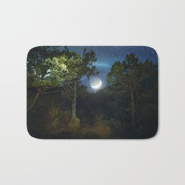 Moonset in coniferous forest Bath Mat