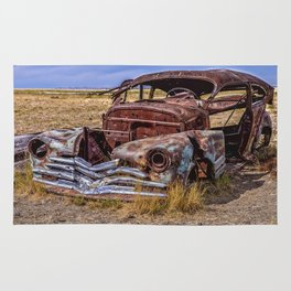 Abandoned car in Badlands ghost town Rug
