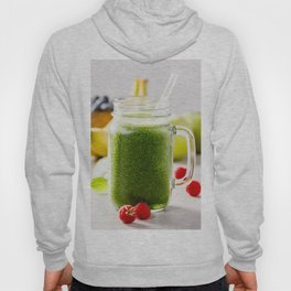 Close-up of green fresh smoothie with fruits, berries, oats and seeds, selective focus. Hoody