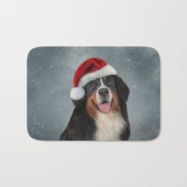 Bernese Mountain Dog in red hat of Santa Claus Bath Mat