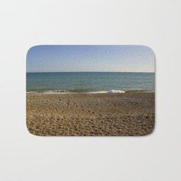 Evening Tide on a cobbled beach Bath Mat