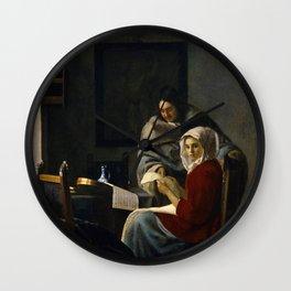 Johannes Vermeer - Girl Interrupted at her Music Wall Clock