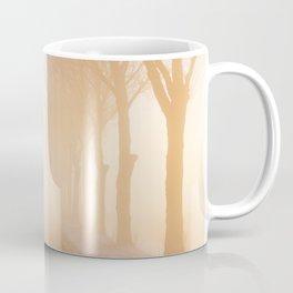 Road through foggy winter polder landscape in The Netherlands, sunrise Coffee Mug