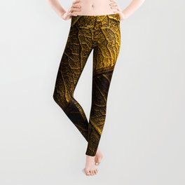 Close-up view on golden leaf from Bodhi tree. Concept of luxury to decorate. Gold-plated leaves deluxe natural illustration design. Leggings